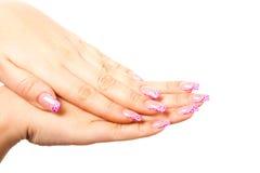Женская рука на изолированной предпосылке Стоковые Изображения RF