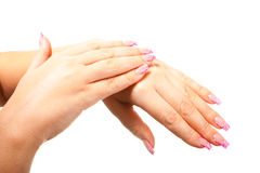 Женская рука на изолированной предпосылке Стоковое Фото