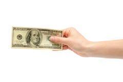 Женская рука принимает или дает 100 долларов США Стоковые Изображения RF