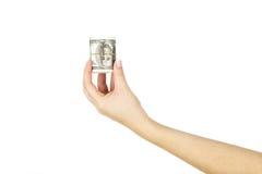 Женская рука с переплетенным стогом долларов на белой предпосылке Стоковое Фото