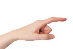 Женская рука указывая при указательный палец изолированный на белизне стоковые фото