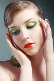 Женская сторона с красочным составом стоковое изображение