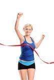 женская финишная черта бегунок к Стоковые Фотографии RF