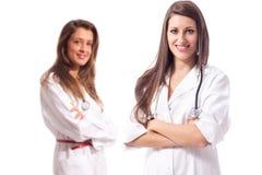 Женские доктора на белизне Стоковые Фото