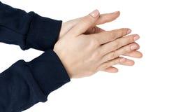 Женские жест и знак рукоплескания выставок руки белизна изолированная предпосылкой Синий пуловер Стоковая Фотография