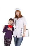 Женские доктор и маленькая девочка Стоковые Изображения RF
