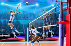 Женские профессиональные волейболисты в действии на грандиозном суде Стоковые Изображения RF