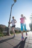 Женские друзья jogging Стоковые Изображения RF
