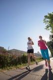 Женские друзья jogging Стоковая Фотография RF