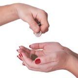 Женские руки держа монетки, с путем клиппирования Стоковая Фотография RF
