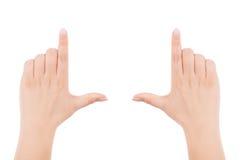 Женские руки делая рамку показывать стоковое фото rf