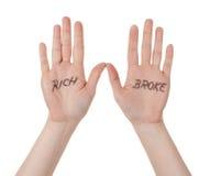 Руки с богатые люди сломали сообщение стоковое фото rf