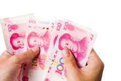 Женские руки подсчитывая деньги в китайских юанях Стоковые Фото