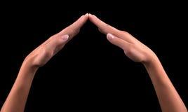 Женские руки показывая домашний знак Стоковые Изображения RF