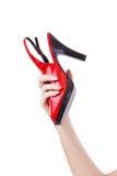 женский ботинок красного цвета удерживания Стоковое Фото