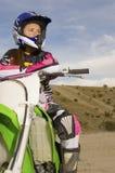 Женский велосипед мотора катания всадника Стоковое фото RF