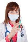 Женский доктор с впрыской Стоковые Изображения RF
