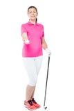 Женский игрок в гольф с шариком и гольф-клуб на белой предпосылке Стоковое Изображение