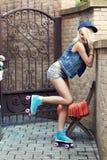 Женский конькобежец ролика Стоковая Фотография RF