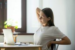 Женский менеджер протягивая ее назад Стоковые Изображения RF
