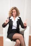 Женский менеджер нажимая назад и предупреждая Стоковое фото RF