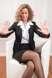 Женский менеджер нажимая назад и предупреждая Стоковое Фото