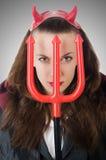 Женский нося костюм дьявола Стоковое Фото