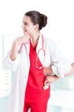 Женский доктор получая деньги от мужского пациента Стоковые Изображения