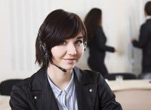 Женский офицер работы с клиентом стоковые изображения