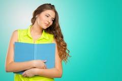 Женский подросток с книгой Стоковые Фото
