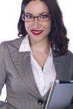 Женский профессионал дела используя ПК таблетки стоковая фотография