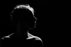 Женский профиль на черноте Стоковая Фотография