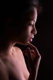 Женский профиль на черноте Стоковое фото RF