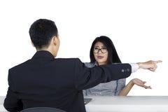 Женский работник вытесненный ее боссом Стоковая Фотография RF