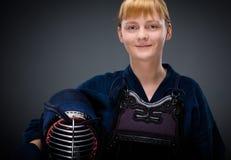 Женский самолет-истребитель kendo с людьми в руке Стоковые Изображения