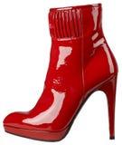 Женский сияющий красный ботинок лакированной кожи с высокой пяткой Стоковая Фотография RF