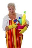 Женский старший с утварями чистки стоковая фотография