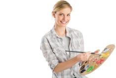 Женский художник с Paintbrush и палитрой стоковое изображение