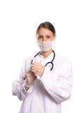 Женский anaesthetist приспосабливая иглу к шприцу стоковое изображение rf
