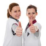 2 женских медсестры показывая успех Стоковая Фотография