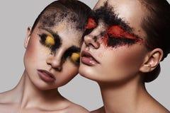 2 женских модели с составом красоты Стоковые Изображения
