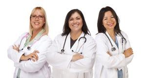 3 женских доктора или медсестры на белизне Стоковое Фото