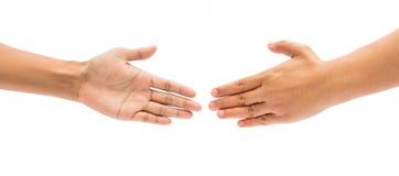 2 женских руки около для того чтобы трясти руки Стоковое Изображение
