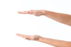 2 женских руки протягивали к одной напротив другой изолированной на белой предпосылке Стоковые Фотографии RF