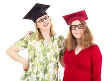 2 женских студент-выпускника Стоковые Фото