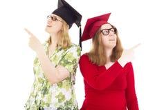 2 женских студент-выпускника Стоковые Изображения