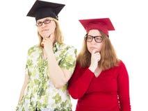 2 женских студент-выпускника Стоковые Фотографии RF