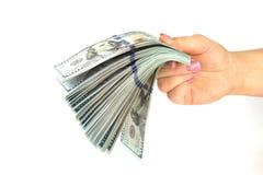 Женское владение руки много банкнот долларов на белой предпосылке конец вверх Стоковая Фотография RF