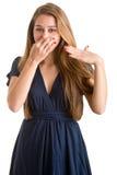 Женское заволакивание ее нос стоковая фотография