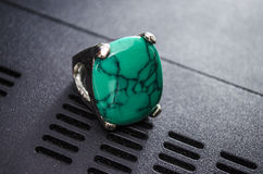 Женское кольцо на белой предпосылке Стоковое Фото